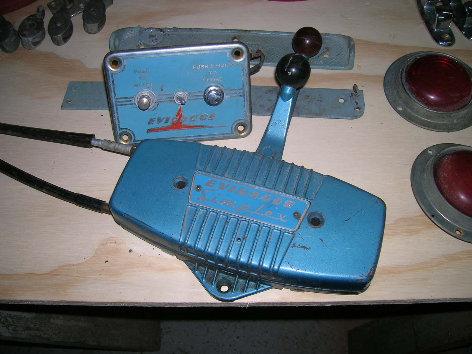 What does a mid-50s Evinrude starter/choke plate and controls look