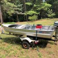 Alumacraft Model R   Boat, motor trailer